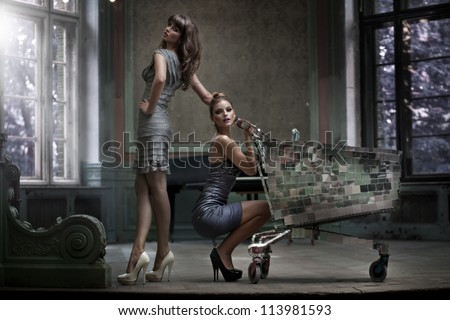 Two sexy women with shopping trolley
