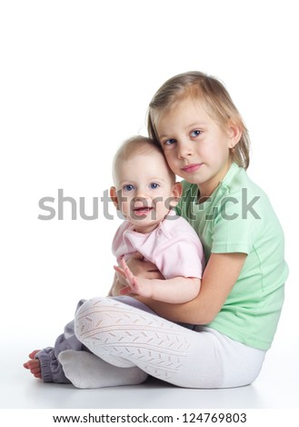 Two sisters embracing on white background