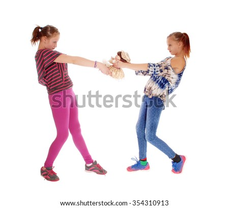 Two sisters in pink and blue tights standing and fighting for a dolly,