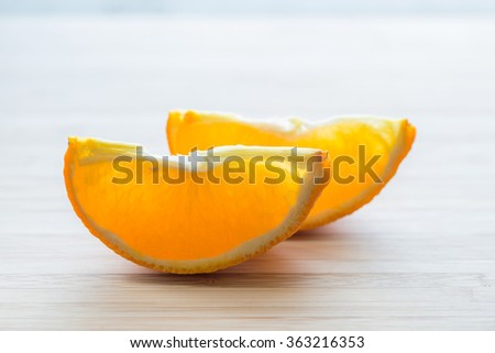 two slices of orange on a light background