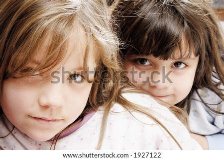two small  girls looking at the camera