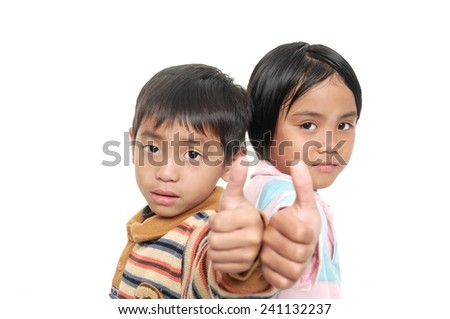 Two smiling little children with thumbs up sign,