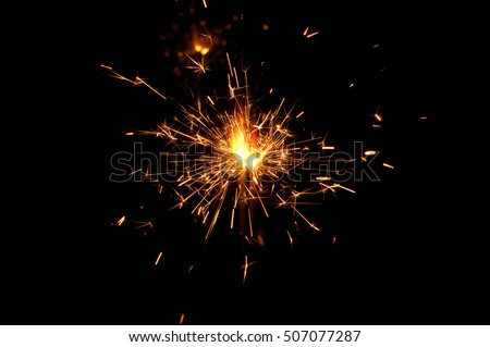 Two sparklers on a black background