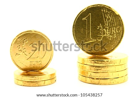 Two Stacks of coins of Euro currency on white.
