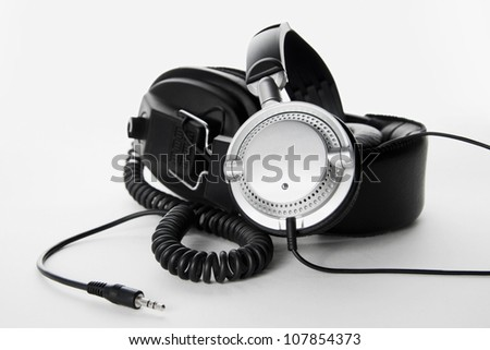 Two, stereo, high quality headphones isolated on white background