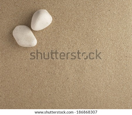 two stones with sand bottom plan view