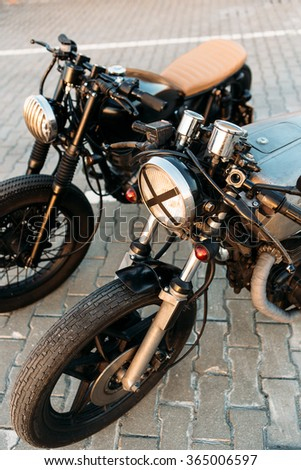 Two Vintage Custom Motorcycle Caferacer Motorbike One With Grill Headlight Another Tape Cross Over Optic
