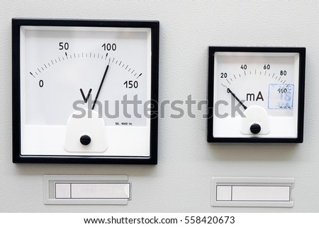 Two volt meter on the metal panel electrical shield.