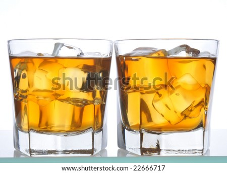 Two Whiskeys on glass bar counter isolated on white