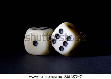 Two White Dices Isolated on Black Background