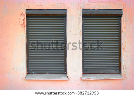 Two windows covered with blinds