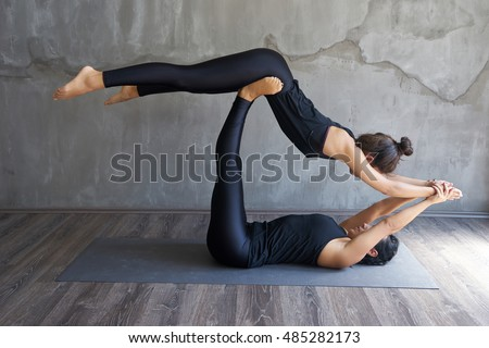 beautiful young woman working out loft stock photo