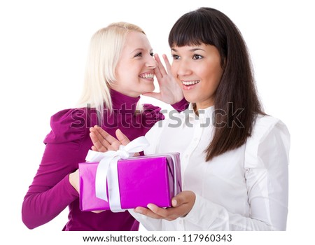Two women with a gift smiling
