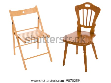 Two wooden chairs isolated on a white background