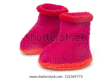 two wool knitted socks, white background