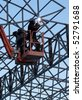 Two workers welded steel structures - stock photo