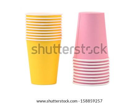 Two yellow and pink stacks of paper cups. Isolated on a white background.