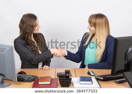 Two young girls acquainted shake hands