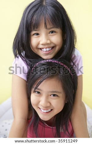 Two young girls in bedroom