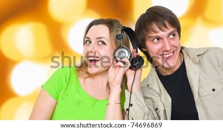 two young people listen music