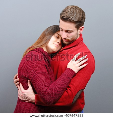 Two young people sharing roamance and hugging