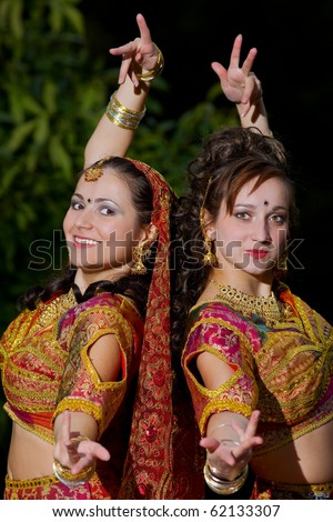 two young woman dance - traditional indian costume