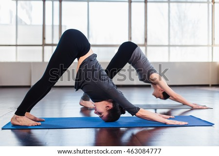 two young women doing yoga fitness stock photo 463084777