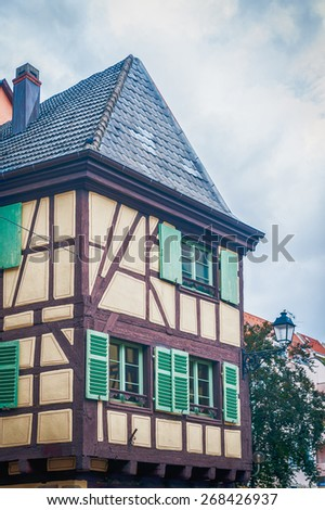 typical half timbered house in alsace, france