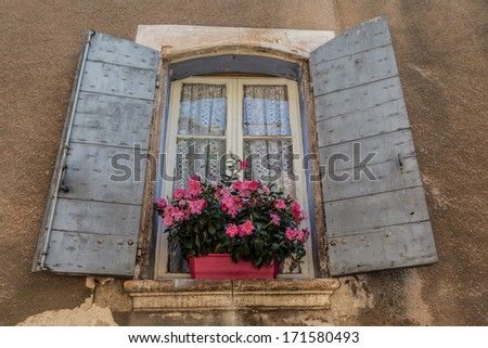 Typical iconic window located in old city of Provence, France
