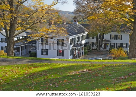 Typical New England cottage during foliage season, South Kent, Connecticut, USA