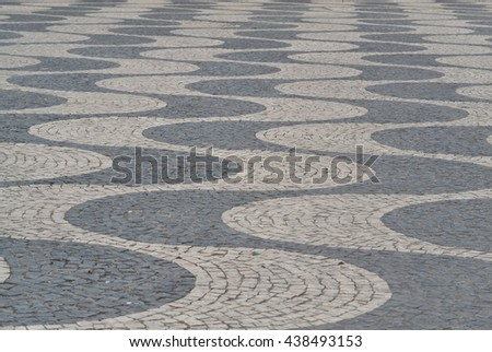 Typical portuguese cobblestone pavement on the street of Lisbon, Portugal