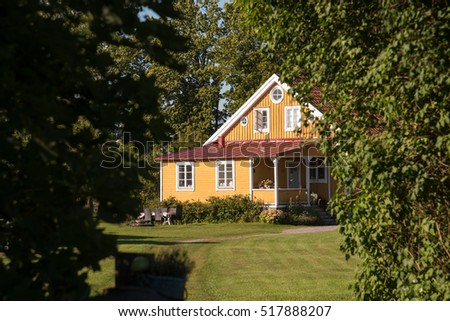 Typical yellow painted farmhouse on the swedish island of Oeland in summer.