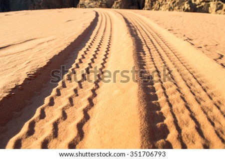 tyre tracks on the desert in jordan