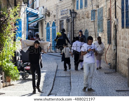 TZFAT (SAFED), ISRAEL - OCTOBER 24, 2014: Busy city street. People are getting ready for Shabbat celebration. Tzfat (Safed) is spiritual and artistic centre of Israel.