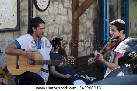 TZFAT (SAFED), ISRAEL - OCTOBER 24, 2014: Unidentified musicians perform in Pre Shabbat celebration on one of the streets. Tzfat (Safed) is spiritual and artistic centre of Israel.