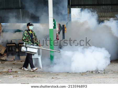 UBON CITY MUNICIPAL, UBONRATCHATHANI, THAILAND - SEPTEMBER 6 : unidentified officer is spraying chemical for anti an outbreak of dengue fever on September 6 , 2013 in Ubonratchathani, Thailand.