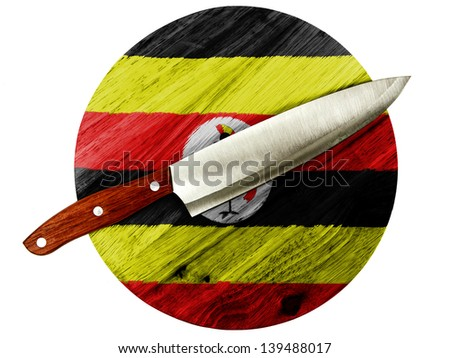 Uganda flag  painted on wooden board with knife