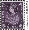 UGANDA - KENYA - TANGANYIKA - CIRCA 1954: A stamp printed in Uganda - Kenya - Tanganyika shows Elizabeth II Queen Great Britain and  branch with coffee berries and leaves, circa 1954 - stock photo