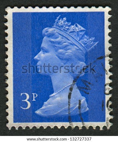 UK-CIRCA 1971:A stamp printed in UK shows image of Elizabeth II is the constitutional monarch of 16 sovereign states known as the Commonwealth realms, in blue, circa 1971.