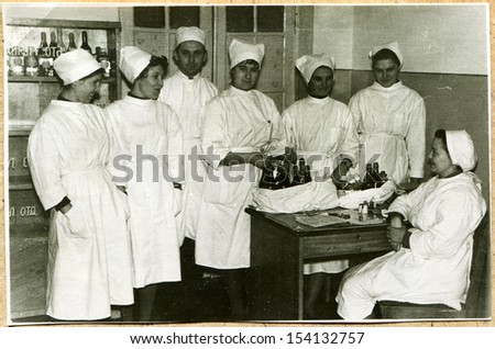 UKRAINE - CIRCA 1964: An antique photo shows nurses in the pharmacy of Oncology dispensary Voroshilovgrad, now Lugansk, 1964