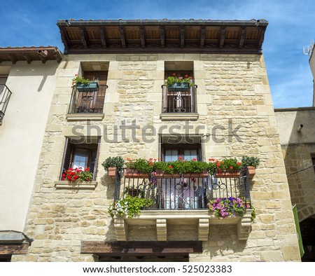 UNCASTILLO - OCTOBER 10, 2015: Traditional architecture in Uncastillo, Zaragoza, Spain, on October 10, 2015. It is a historic town and municipality in the province of Zaragoza, Spain