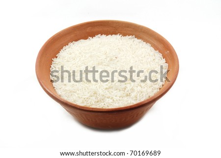Uncooked rice in a ceramic bowl isolated on white background