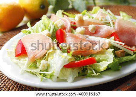 Uncured ham on fresh salad