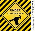 Under Construction Sign With Yellow and Black Line Background - stock photo
