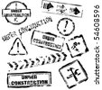 under construction stamps - stock photo