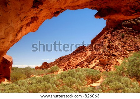 Under Mushroom Rock:  Rock formations frame a vivid blue sky in this desert landscape with space for your copy.