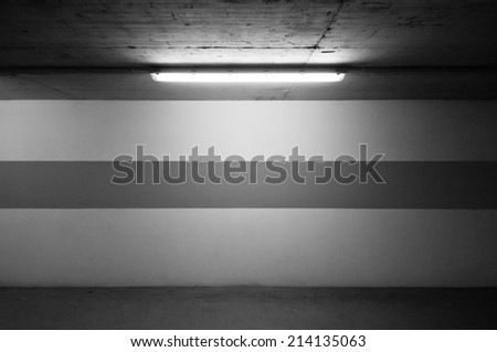 Underground parking wall and a lamp