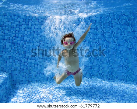 Underwater child, jump to the water in swimming pool