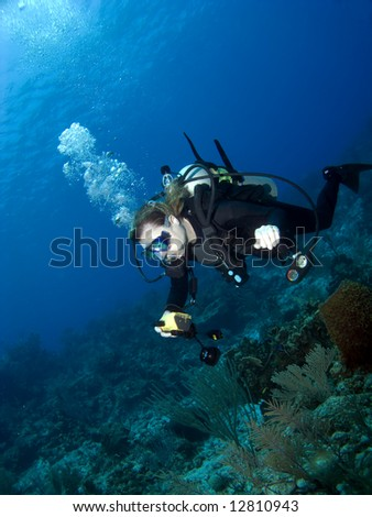 Underwater Photographer swimming over a Cayman Brac Reef