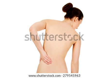 Undressed woman with backache from behind.